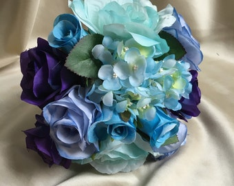 Mint, Blue and purple rose and blue hydrangea bouquet with matching boutonnière