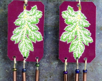 Leaf image Lighter than Air dangle earrings in purple and green.