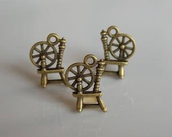 Antique bronze metal spinning wheel charm