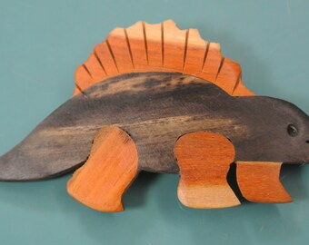Lovely vintage 1970s handcrafted brown/ black/ beige brown wood dinosaur brooch exellently made in the philliphines