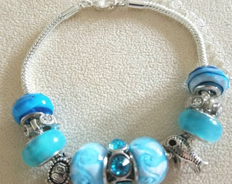 Beautiful Beaded Bracelet with Ocean Theme with Blue and White Beads and Silver charms