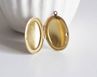 1 brass - 32mm x 23mm oval locket pendant