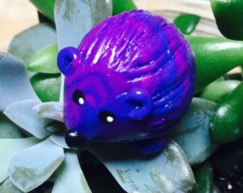 Mini marble Hedgehog of Hedgehog Bog shown  violet purple and royal blue swirl