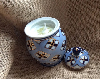 Soy candle in blue and gold ceramic pot with lid