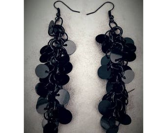 Earrings with black sequins