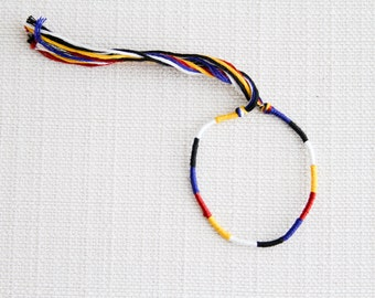 Friendship Bracelet Yellow Blue Black White and Red Embroidery Threads / Stocking Stuffer