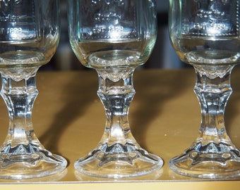 Preserving Jars with Screw Top Lids on a beautiful glass wine stem.
