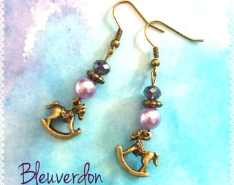 Bronze rocking horse earrings and purple beads