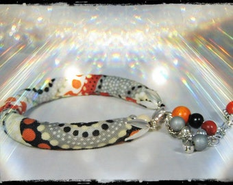 SOLD - Bracelet with chain - the daughter of the STEPPES - multicolored fabric with dominant black, grey, orange, Red