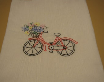 Flour sack towel and embroidered bike and flowers.