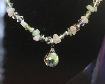 Necklace.  Hand strung, natural stone and Swarovski crystals beauty!  The picture doesn't show this true beauty in shimmering colors!