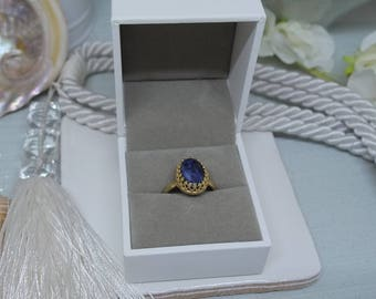 Brass gallery wire ring with sodalite cabochon