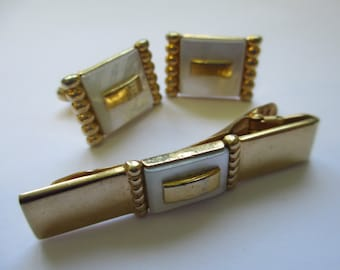 """Vintage  signed """" Anson"""" cufflinks gold tone with mother of pearl background used"""