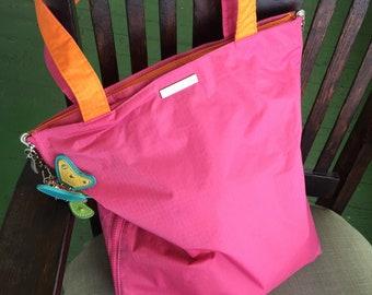Reduced! Vintage BAGGALLINI reversible pink orange tote travel bag