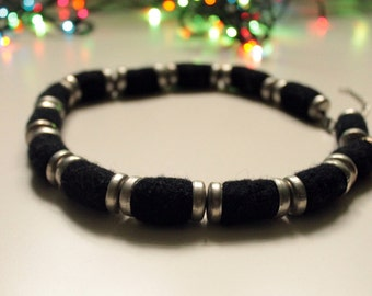 Black wool necklace with metal clasps, beads