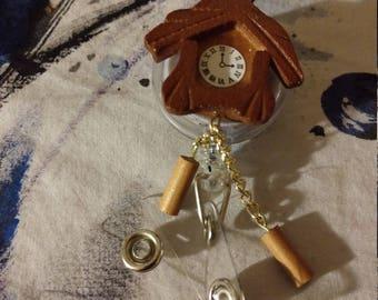 Cuckoo clock retractable ID holder