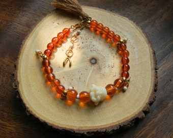 Buddha Orange Charm and Tassle Bracelet