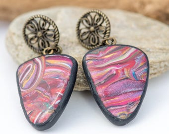 a pair of triangular oreillle multicolor polymer clay