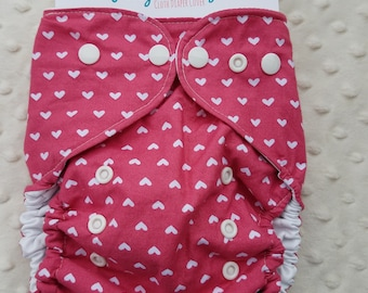 One Size, cloth diaper cover, cotton over PUL with AI2 option, white hearts on dark pink