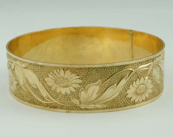 Gold Tone Wide Floral and Narrow Oval Bangle Bracelets fitting up to 7-1/2 inch wrist.