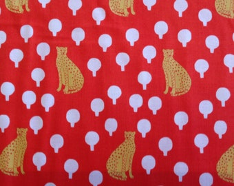 Cheetahs on Persimmon cotton by Sarah Golden for Andover Fabrics pattern 8762 color O