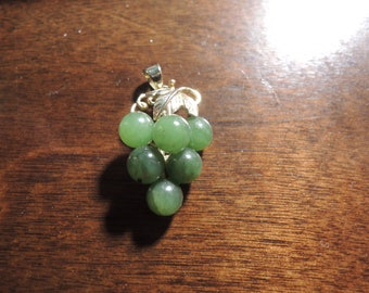 Natural Jade Pendant Bunch of Grapes, The leavbes are gold Bonded  1988 Vintage  Mint condition