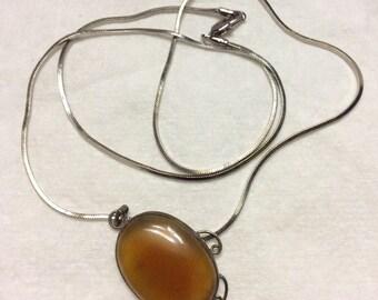Antique genuine amber pendant necklace .