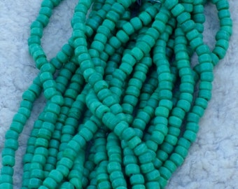Green glass crow beads , 9 mm opaque