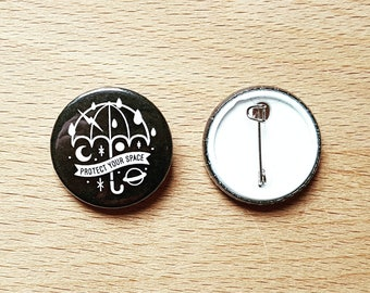 1 Inch Pin Badge: 'Protect Your Space' Umbrella