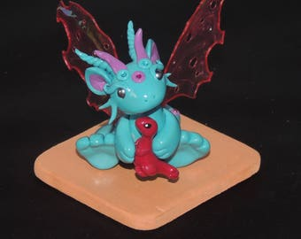 Pink and Blue winged Dragon with his teddy