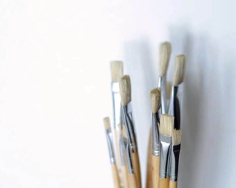 Paint brush set of 12. Flat paint brushes made of stiff hog hair with long wooden handle. Oil painting, mural painting, artist paint brushes