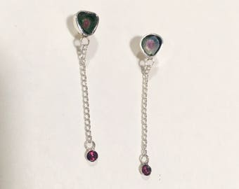 Watermelon Tourmaline dangling a Garnet