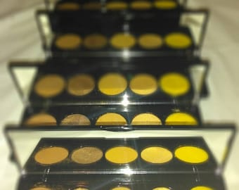 Gold, brown, and bright sunny yellow five pan palette