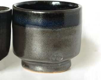 Small 'chawan' tea bowls inspired by Japanese tea bowls with beautiful black glaze and deep blue accents