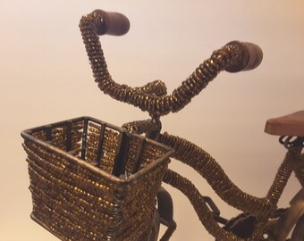 Reduced Yes....a beaded bicycle with basket,amber colored beads