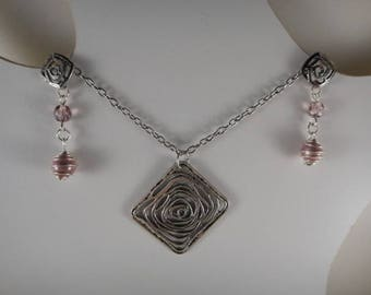 Pink pendant stylized in a square antique silver and with same smaller pattern and Pearl Earrings
