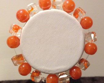 Bracelet. 16cm .Features 10mm round Orange Glass beads. Electro plated Glass cube beads