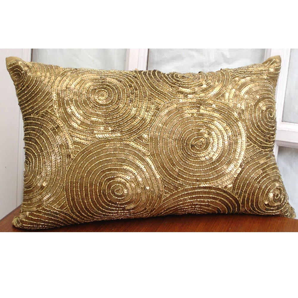 pillow a decorative compass look bold catalog highland throw gold pillows taylor for