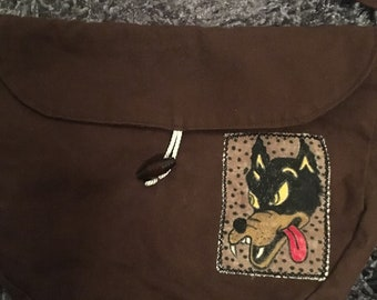 Brown purse with hand painted Grateful Dead Dire Wolf patch.