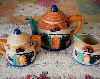 Vintage Thatched Roof Cottage Teapot with Creamer and Sugar bowl.