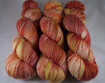Hand Dyed Sock Yarn 100% superwash extrafine merino, hand dyed wool, variegated sock yarn, yellow, orange, red
