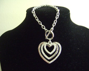 Silver tone Heart within Hearts and Rhinestones Bracelet