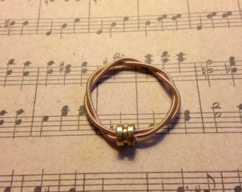 Reused brass bass guitar string ring with gold-toned string post for men or women