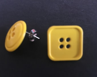 Yellow mismatch button stud earrings.