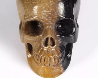 """4.2"""" fossil agate skull  get it while you can."""