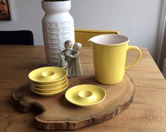 Fresh Edam-egg caps and milk jug