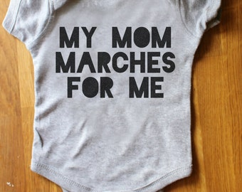My mom marches for me - women's march - million woman march - one piece baby outfit - creeper - jumper - romper - feminist - activist - USA