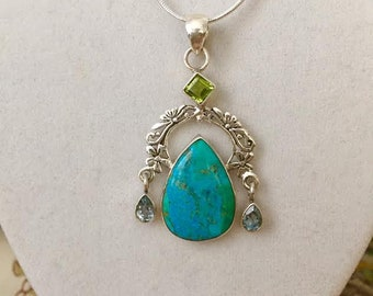 Sterling Silver Turquoise Pendant With Peridot and Blue Topaz on a Sterling Silver Snake Chain.