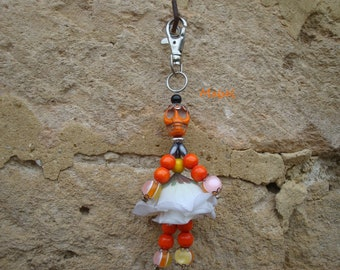 Bag charm doll, skull, orange and yellow fabric flower.