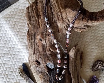 Beaded necklace with deer antler